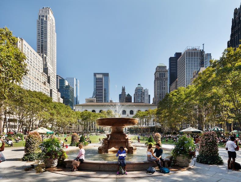 ... surrounded by iconic skyscrapers, Bryant Park is visited by more than  12 million people each year and is one of the busiest public spaces in the  world.